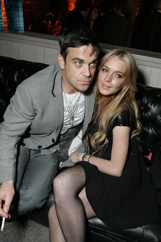 Lindsay Lohan y Robbie Williams en Tudor after-party